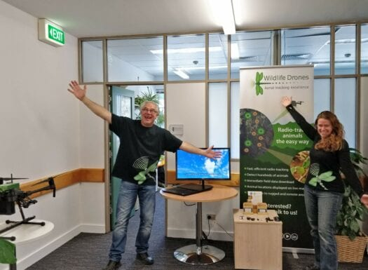 debbie and gerard from wildlife drones smiling with their arms outstretched in front of their office at CEAT